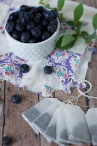 A bowl Blueberry and black tea bags