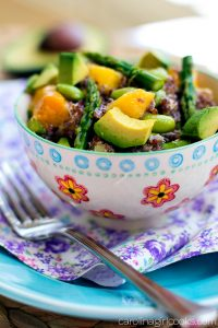 A delicious asparagus and mango quinoa salad placed on table