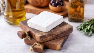 a goat cheese on cutting board