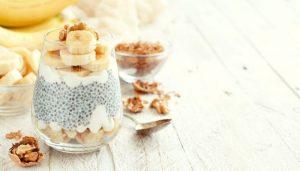 banana coconut chia pudding and walnut on table