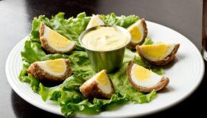 Scotch eggs serve with creamy mustard sauce