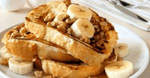 French toast with banana on top